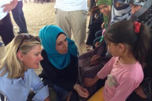 International Development Secretary, Justine Greening, talking with Syrian children at a UK-funded clinic in the Zaatari refugee camp, Jordan. Picture: Peter Millett/British Embassy Jordan
